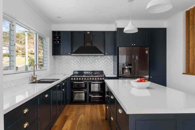 Modern kitchen with brass fittings and SMEG oven