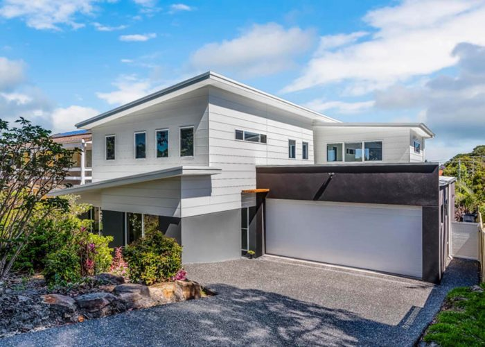 Front facade with view of double garage